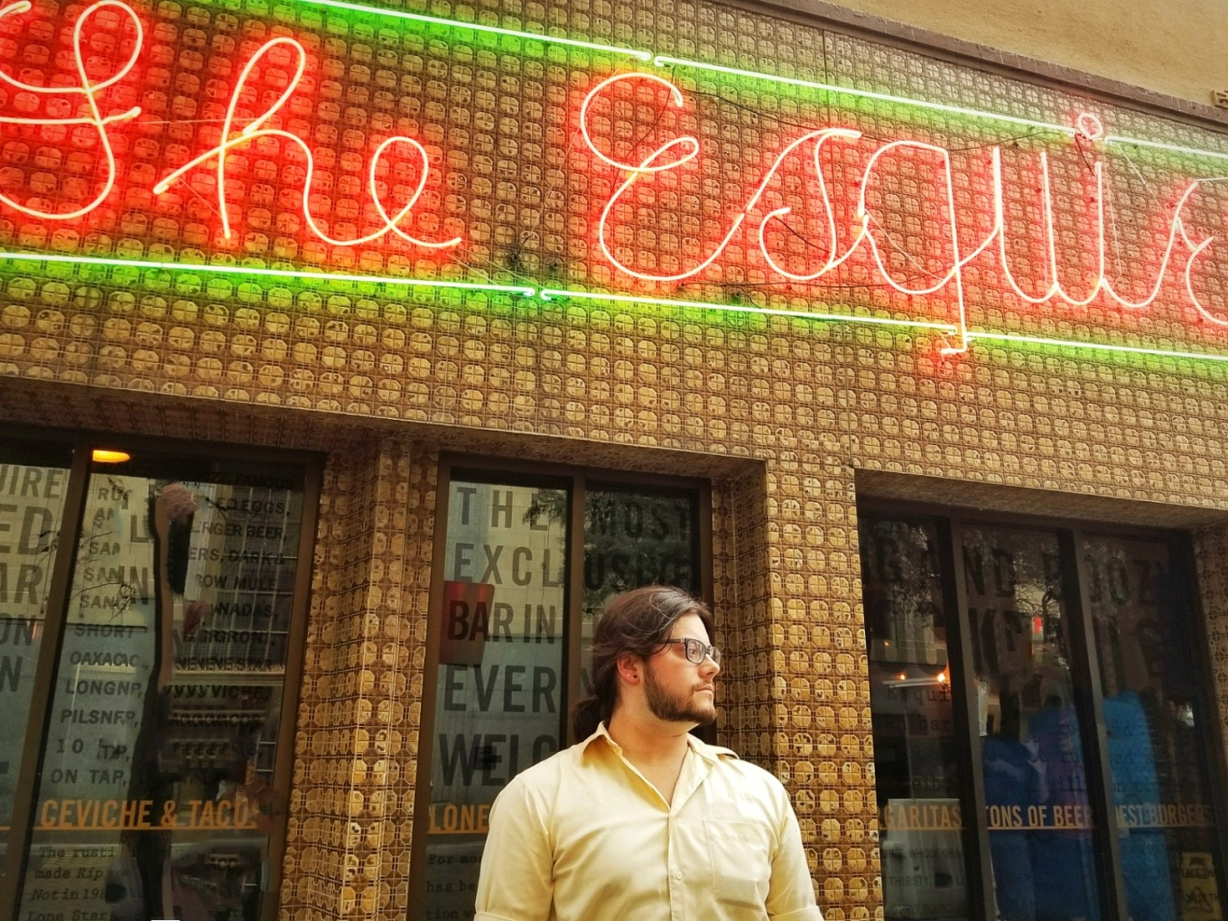 J in front of The Esquire Tavern in San Antonio
