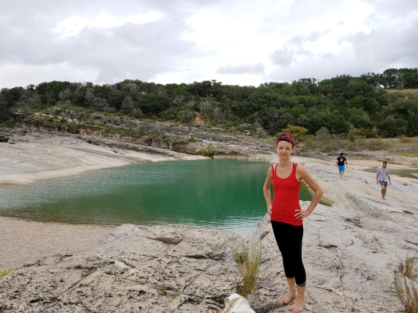 Beia, J, and Max exploring the limestone steps that make up the Pedernales Falls while the Pedernales River is low