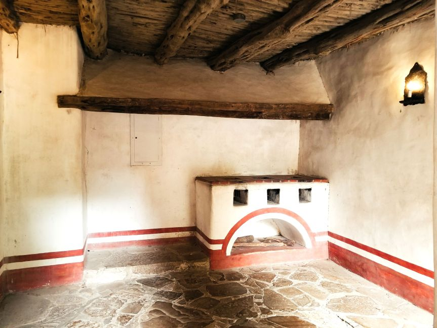 Interior Room with fireplace and Native American motif in Mission San Jose in San Antonio