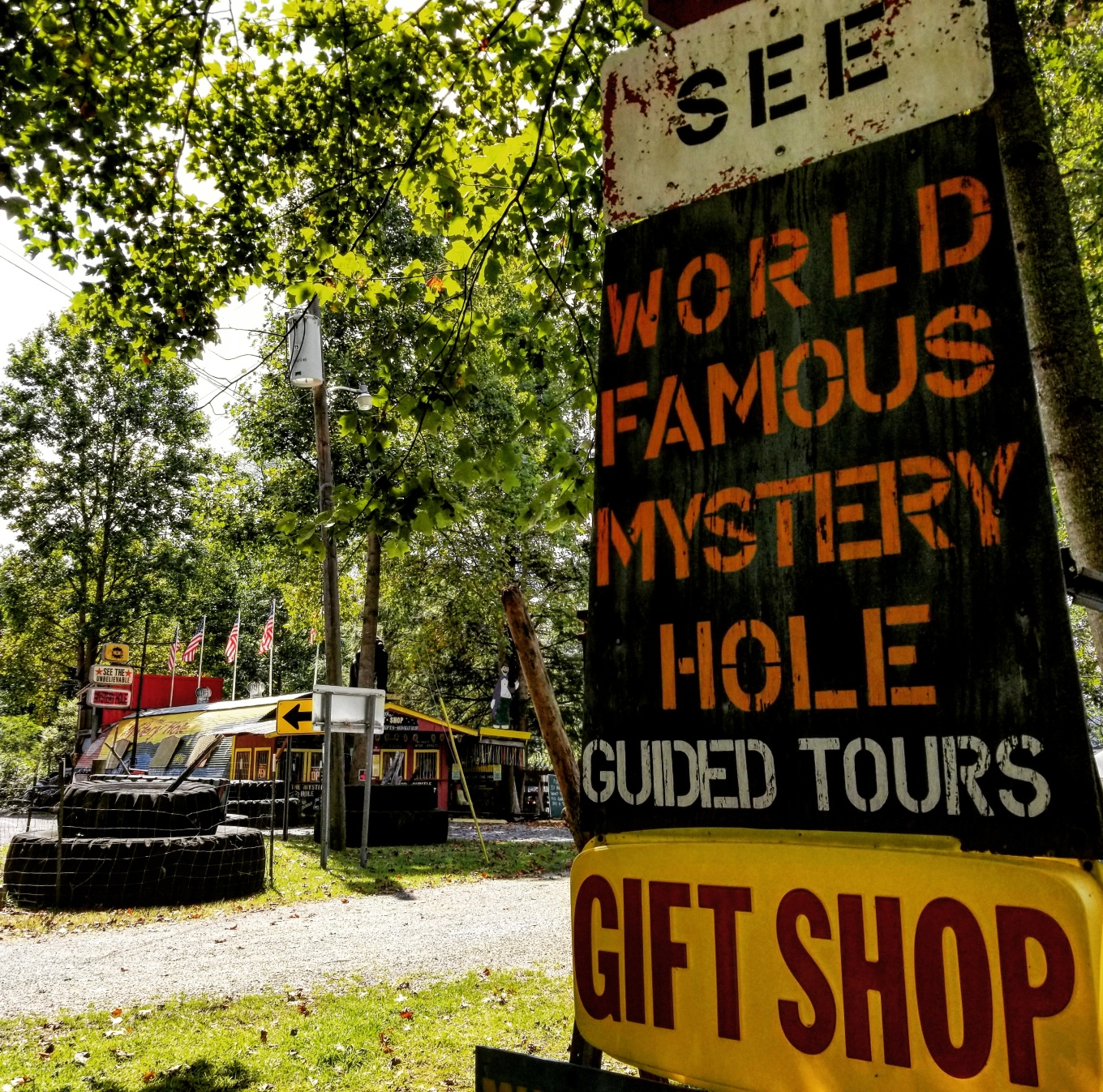 A sign advertising the world famous mystery hole in West Virginia