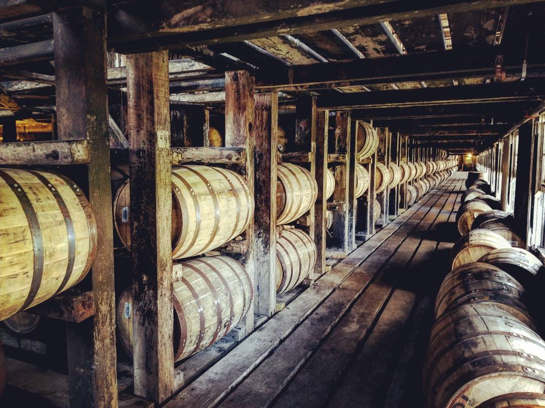 The inside of a rickhouse at the Wild Turkey Distillery, filled with barrels of aging whiskey