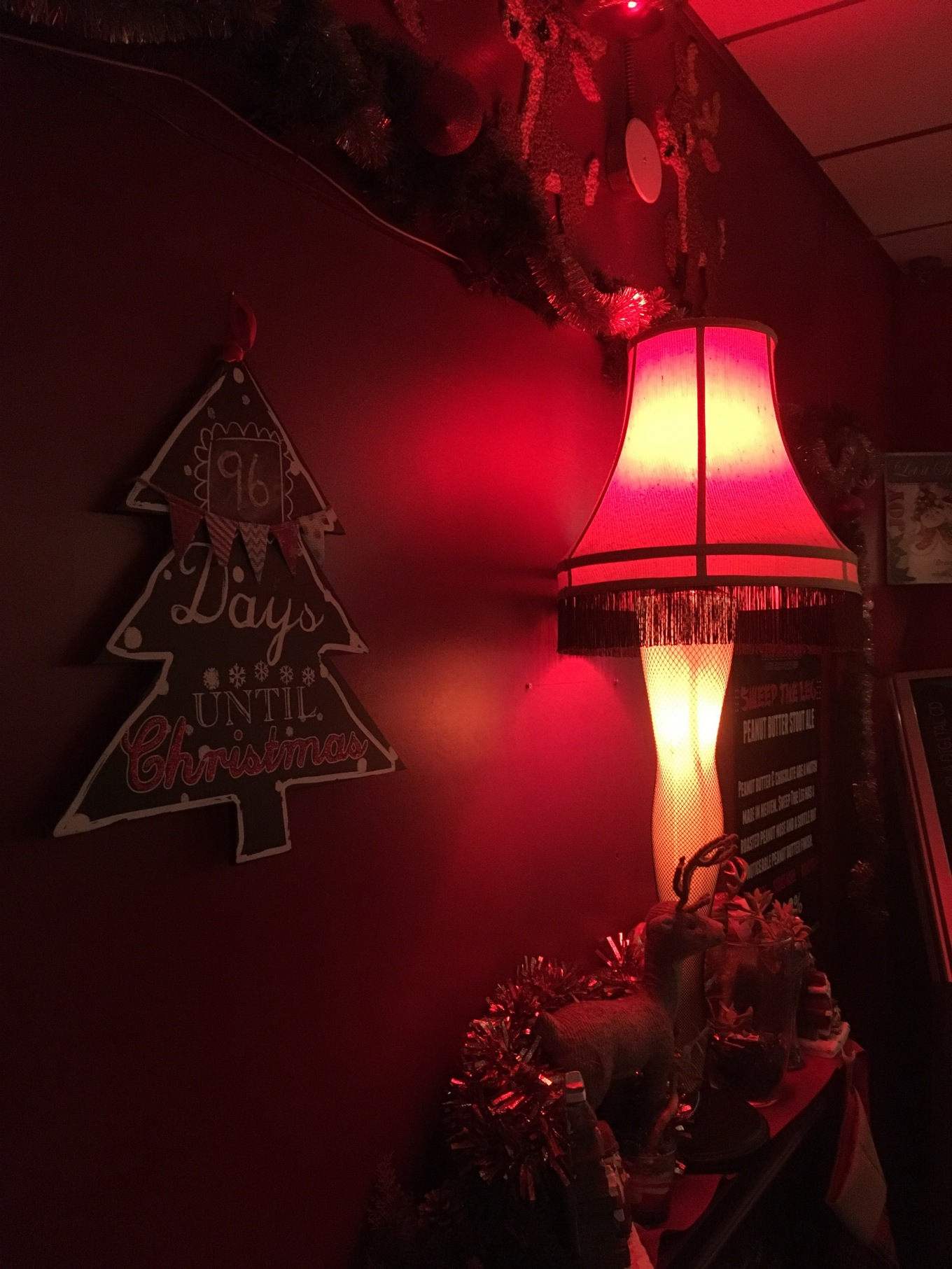 Sign saying 96 days until Christmas and replica of leg lamp from the movie A Christmas Story decorations at La La's Little Nugget in Austin, Texas