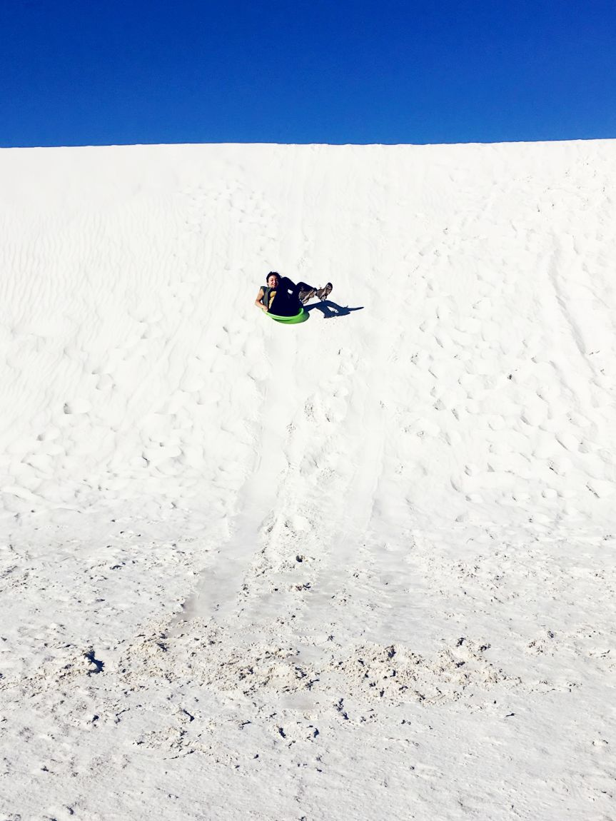 Y sledding at White Sands National Monument