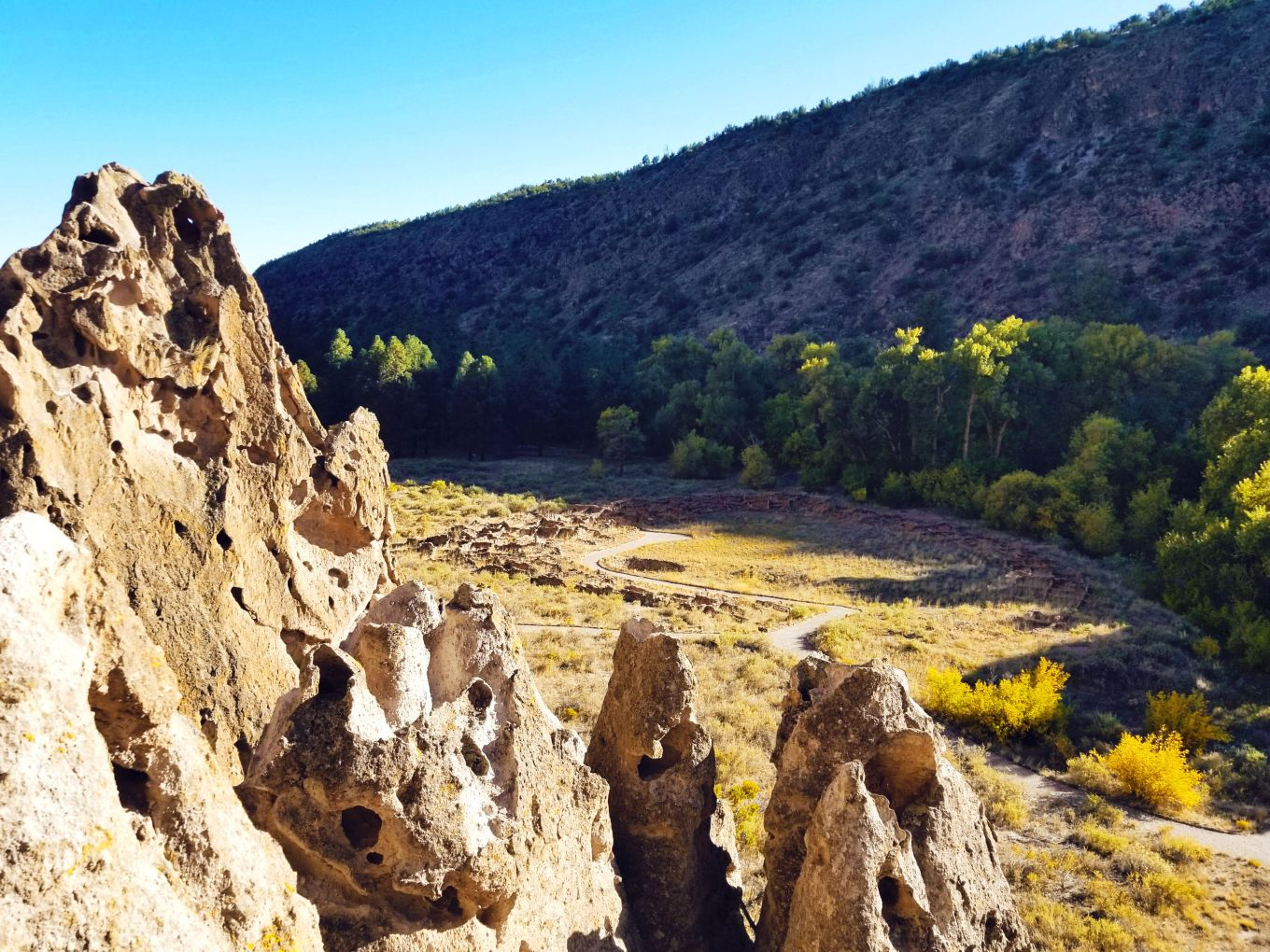 View of Tyuonyi ruins from cave dwellings, Bandelier National Monument