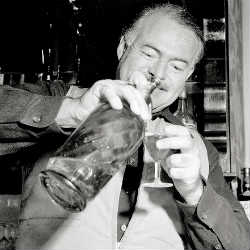 Hemingway holding a martini