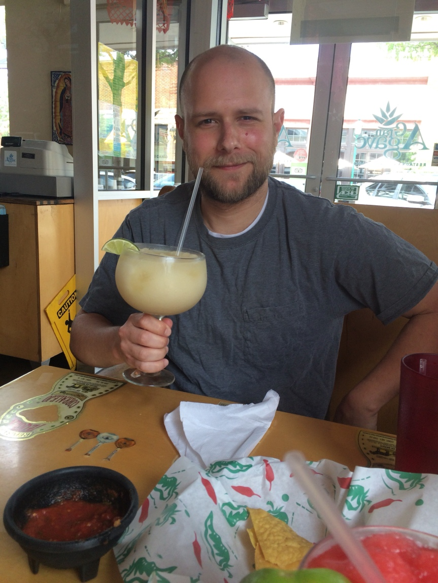 A man about to enjoy a massive 220z margarita