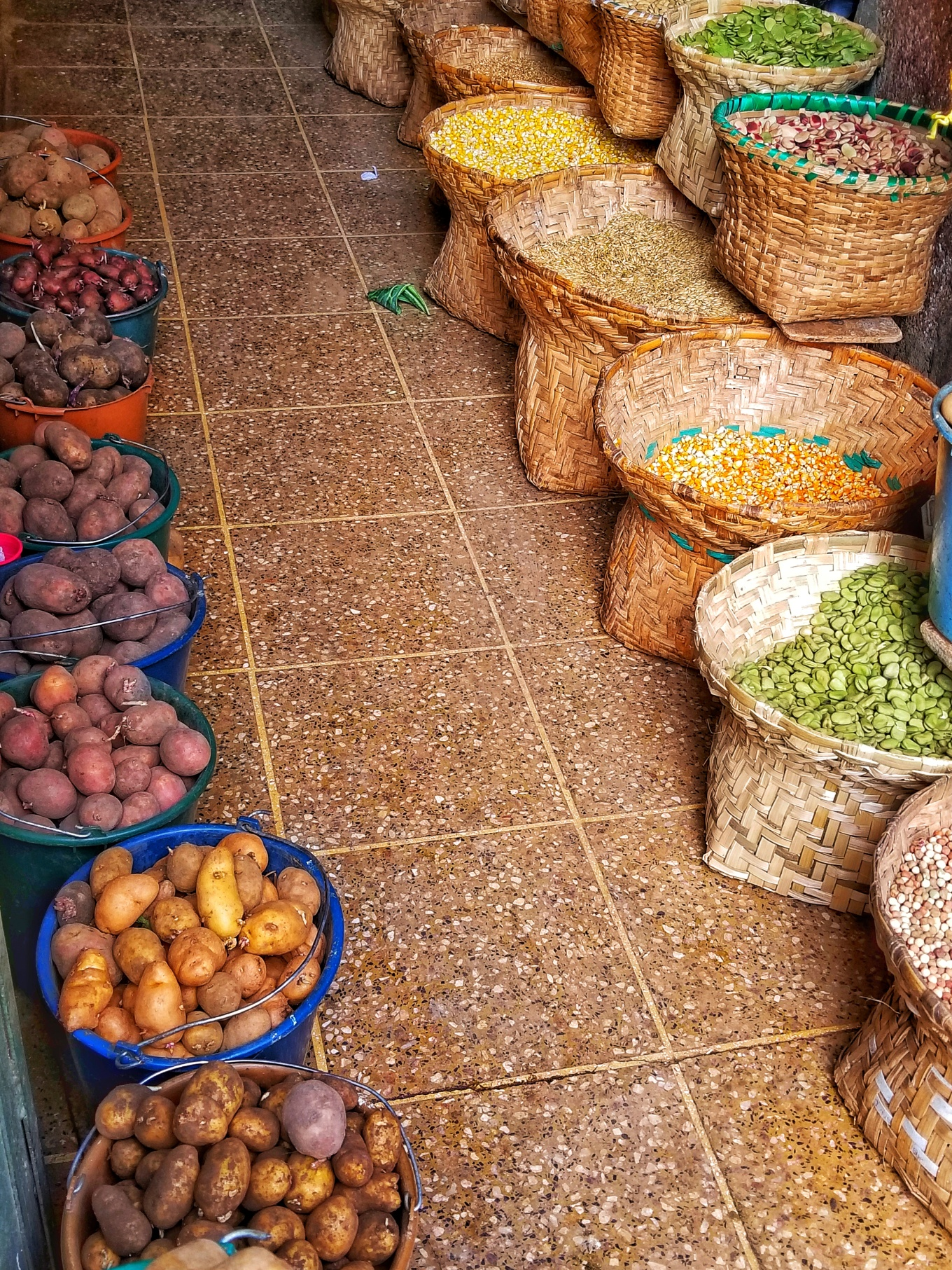 Baskets of Potatoes and Legumes at Market in Cuenca, Ecuador