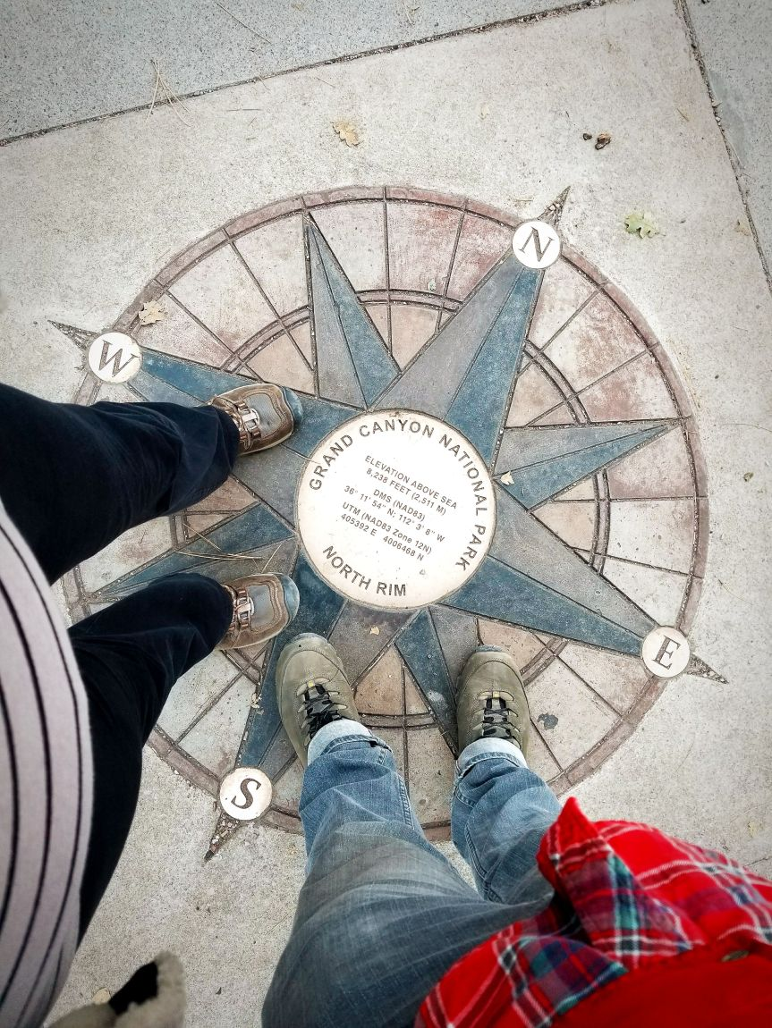Standing on the compass at Grand Canyon National Park's North Rim