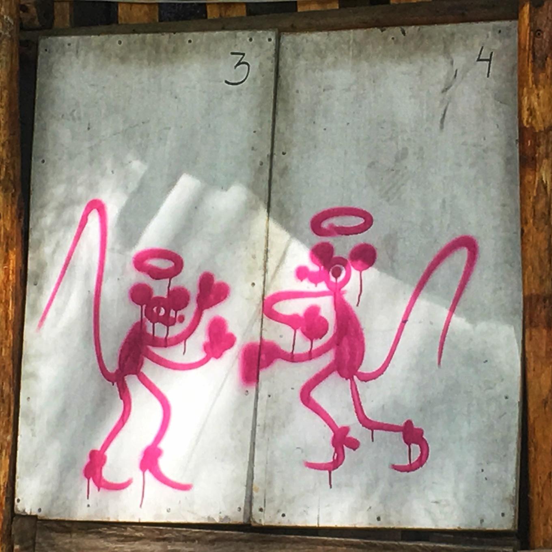 Two graffiti rats boxing