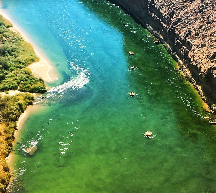 Silt visibly churning in the Colorado River