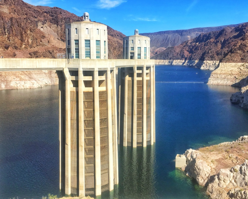 The dam's intake towers over Lake Mead.