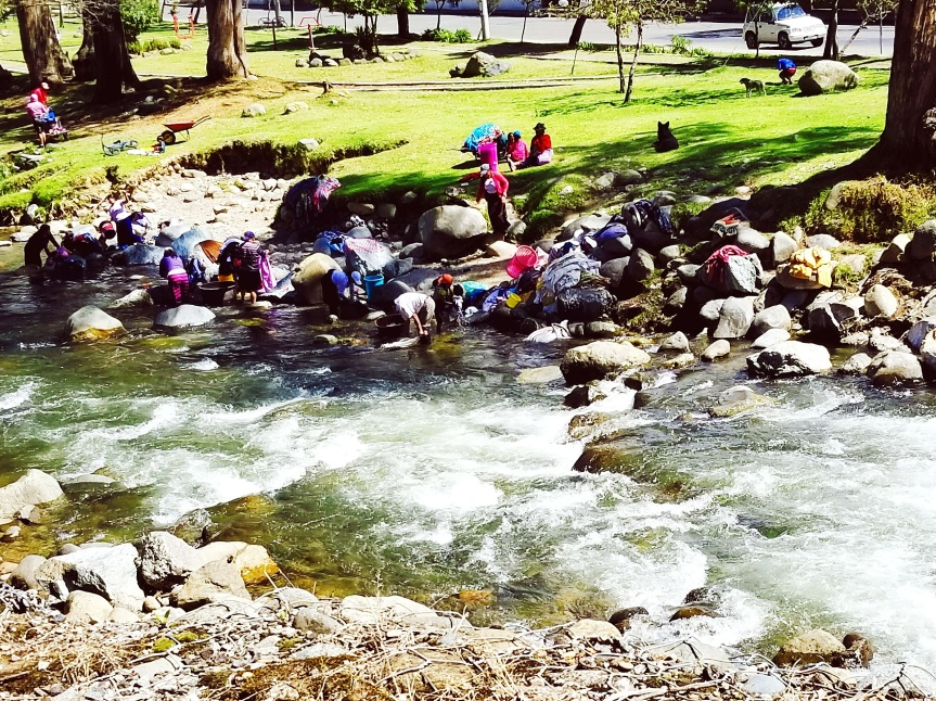 Women Washing Clothes in the Rio Tomebamba, Cuenca, Ecuador