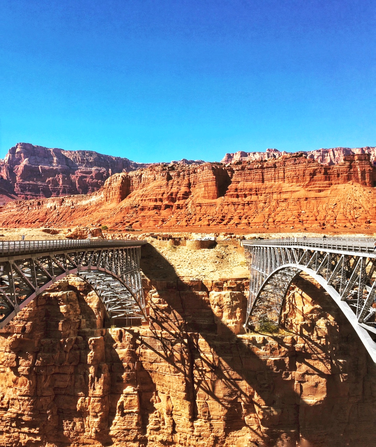 A view of the parallel original and modern Navajo Bridges