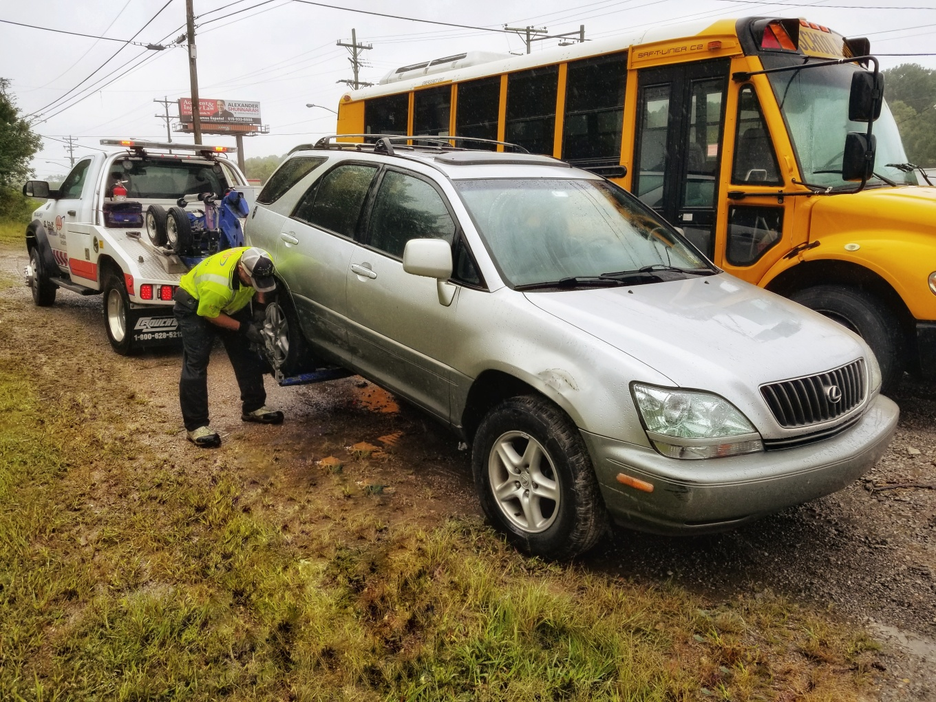 Car being hooked up to a tow truck