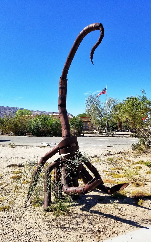 A welded-iron scorpion sculpture