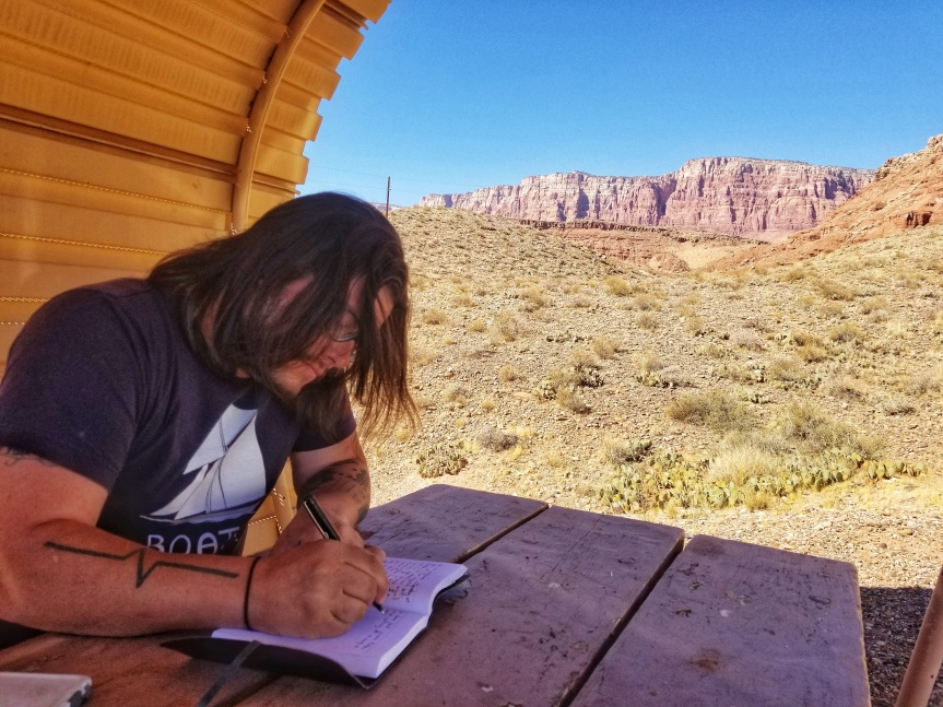 J journaling at our campsite in Glen Canyon National Recreation Area, AZ