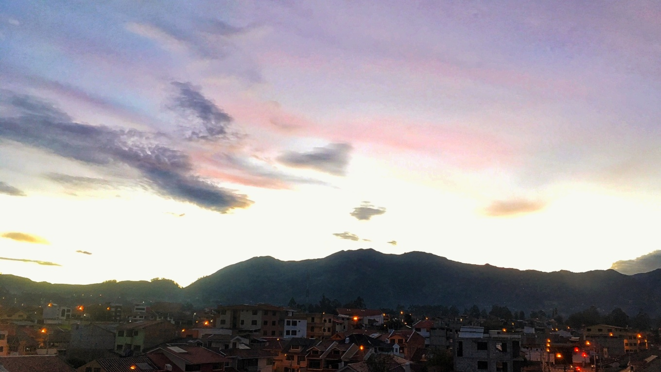 The sun setting behind the Andes Mountains in Cuenca, Ecuador.