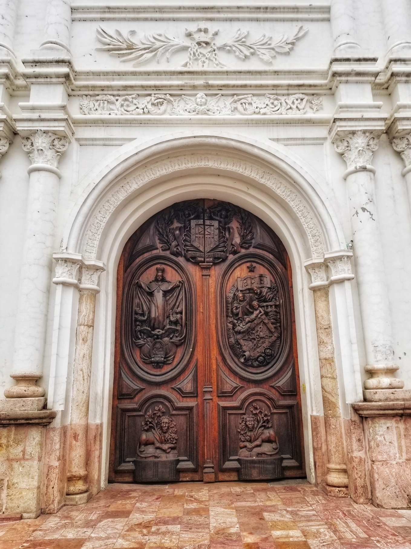 Intricate carvings on doors of a cathedral in Cuenca's Centro Histórico