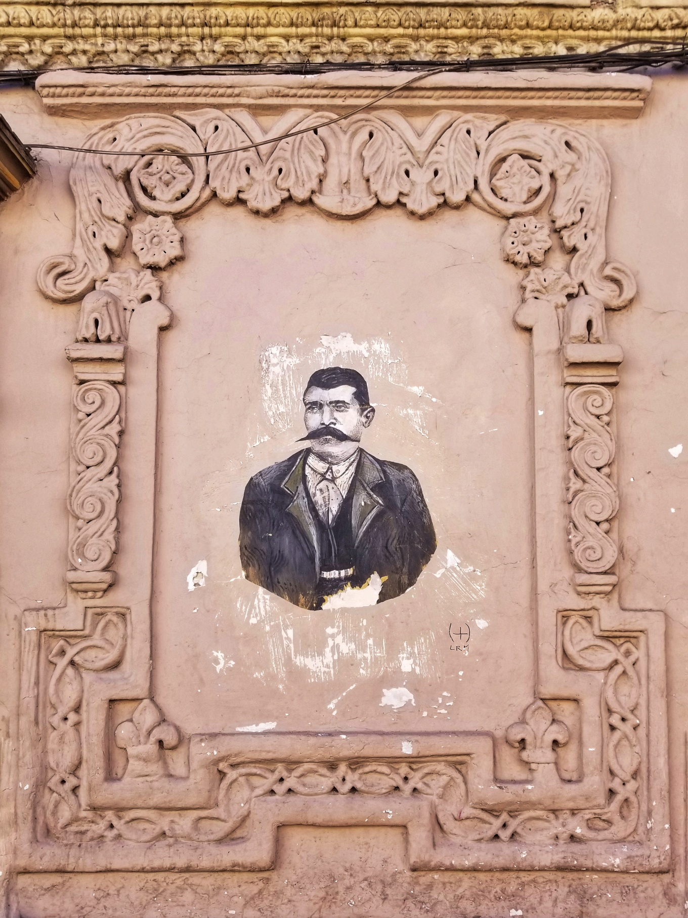 Street art framed gets an architectural upgrade along Calle Larga.