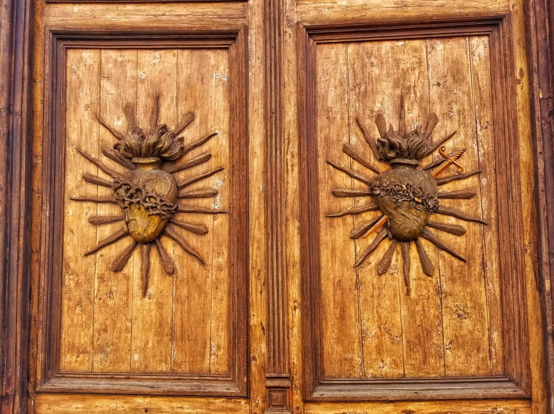 Carved doors along Calle Larga