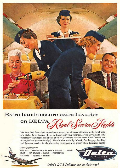 Flight attendants doting on guests in 1950's Delta advertisement